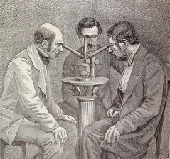 3 scientists 1 microscope